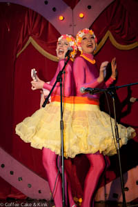 brightly coloured female musical double-act pluck and shake their stuff.
