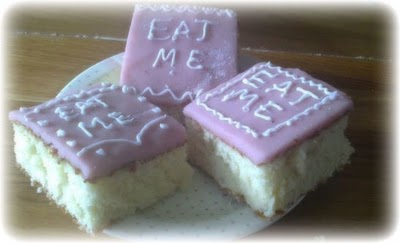 three tasty cakes with purple icing: also iced in white the words 'eat me'